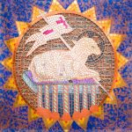 detail from a tapestry of a lamb, flag, and Bible